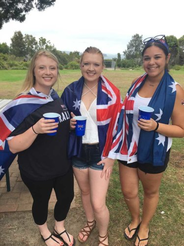 Programs - Girls in Australian Flag @Uluru | Professional Education Programs Abroad